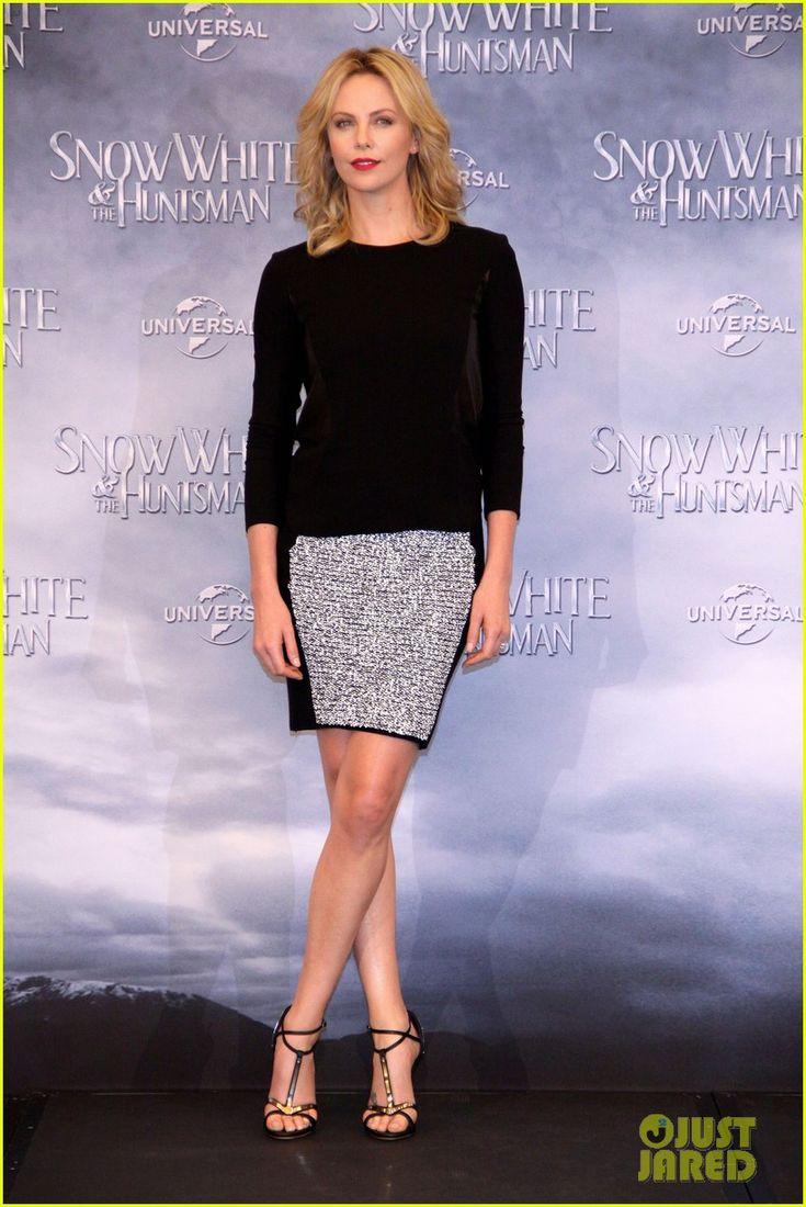 Charlize Theron.  Berlin, Germany.  Rag & Bone top.    Alexander Wang skirt.    Giuseppe Zanotti shoes.