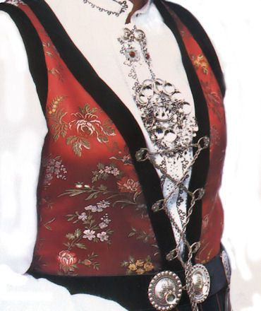Part of the Bunad is the silver decorations from broaches to buttons and clasps, belt buckles and earrings.
