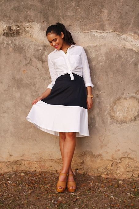 A Line skirts with a wraparound shirt or tshirt that 'skims' the curves, are a great choice for the Petite Plus Sized Apple. Keep the length just above or just below the knee, and aim for vertical details NOT horizontal like this one. This one in a solid colour would be perfect.