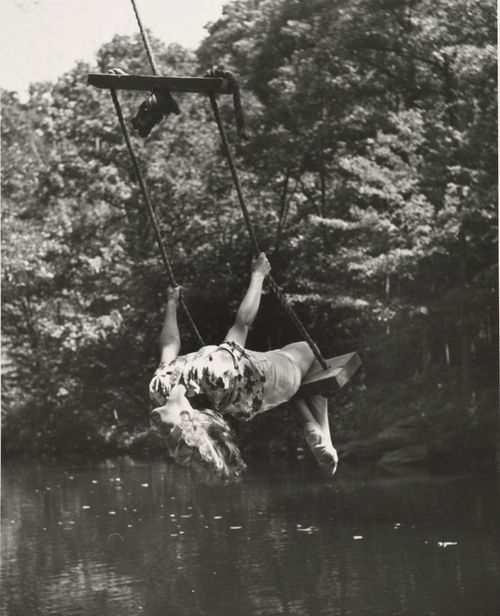 Maybe not so much but I love this picture. The black and white, the swing over the water........ i wish it were me :)