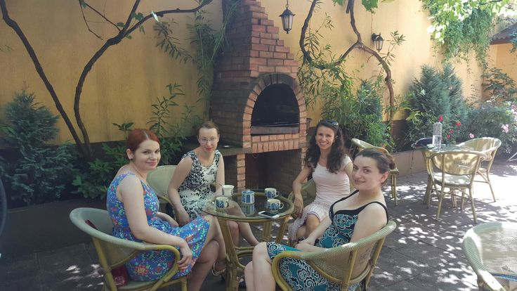 Girls drinking caffee and relaxing in the garden