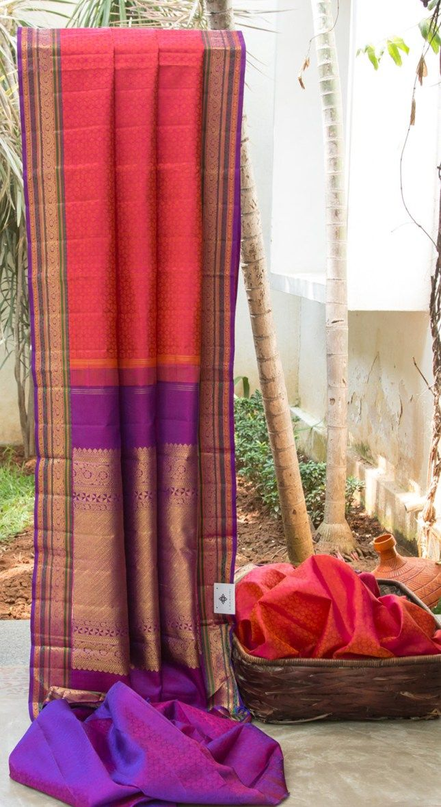 EYE CANDY MAGENTA IS INTRICATELY WOVEN IN ORANGE ALL OVER IS UPLIFTED BY VIOLET WITH GOLD AND GREEN DETAILED BORDER AND PALLU GIVING THIS SAREE GRACEFUL FINISH.