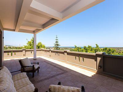 Rethymno villa rental - Large verandas equipped with patio furniture.