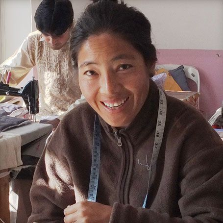 Meet Wangmo. She first started working for Eternal Creation's designer and founder, Frances Carrington, as a nanny. Wangmo spent two and a half years caring for Frances' two young children while she was at work. When the children were old enough to start school, Frances helped train Wangmo as a tailor at the Eternal Creation workshop. Wangmo learned fast, and today is an expert tailor who specialises in womens tops, girls dresses and pyjama sets.