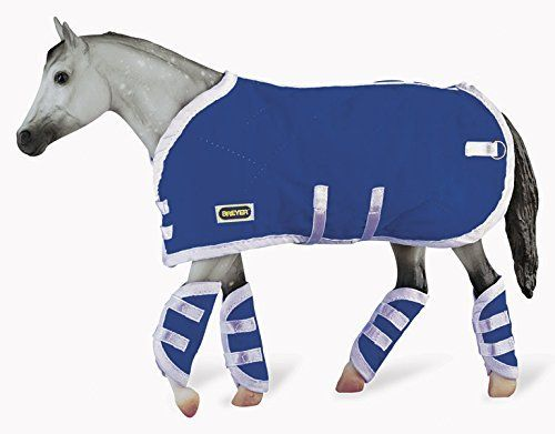 This quilted blue blanket from Breyer is packaged with 4 blue quilted shipping boots, perfect for trips in the trailer! Made with protection in mind, bright blue shipping blanket has matching authentic shipping boots with hook and loop straps. The Breyer blanket and shipping boots can be used to... more details available at https://perfect-gifts.bestselleroutlets.com/gifts-for-pets/for-horses/product-review-for-breyer-traditional-blanket-shipping-boots-horse-toy-accessory-set