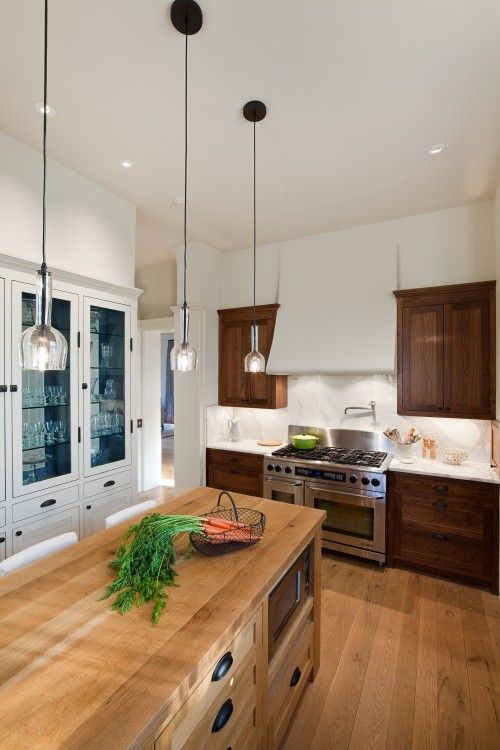 Not crazy about the dark cabinets but I strangely love the wood on wood with the floor. And of course the white glassed cabinet wall