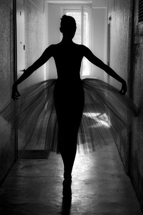 We usually see ballerinas in very pink pastel photos, and its somewhat refreshing to see a more dark photo. The black and white photo really outlines her form.