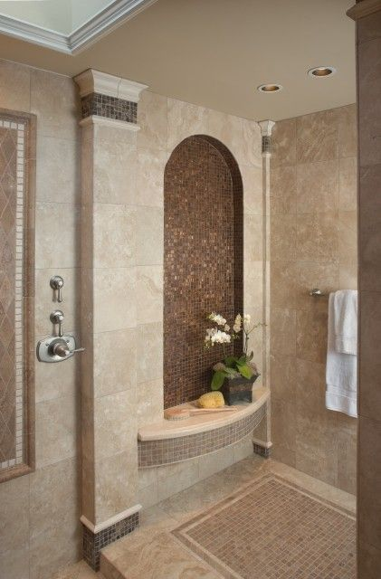 This Roman shower is perfection...just the right amount of mosaic and a slightly distressed crown molding.