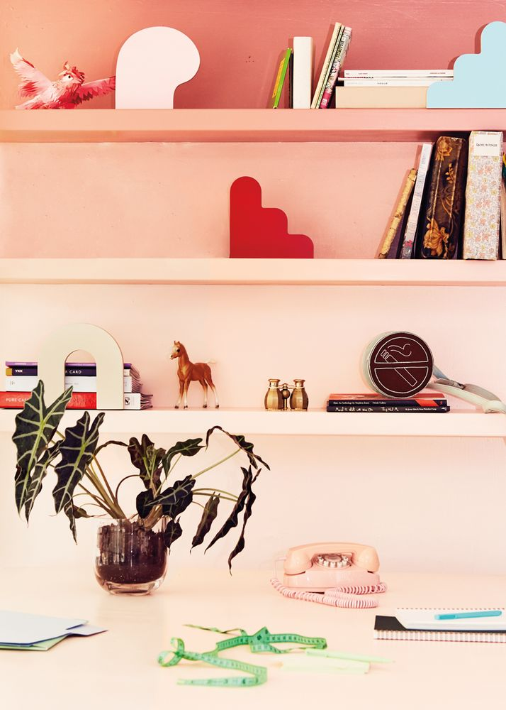 Ombre pink shelving in home office - so pretty!