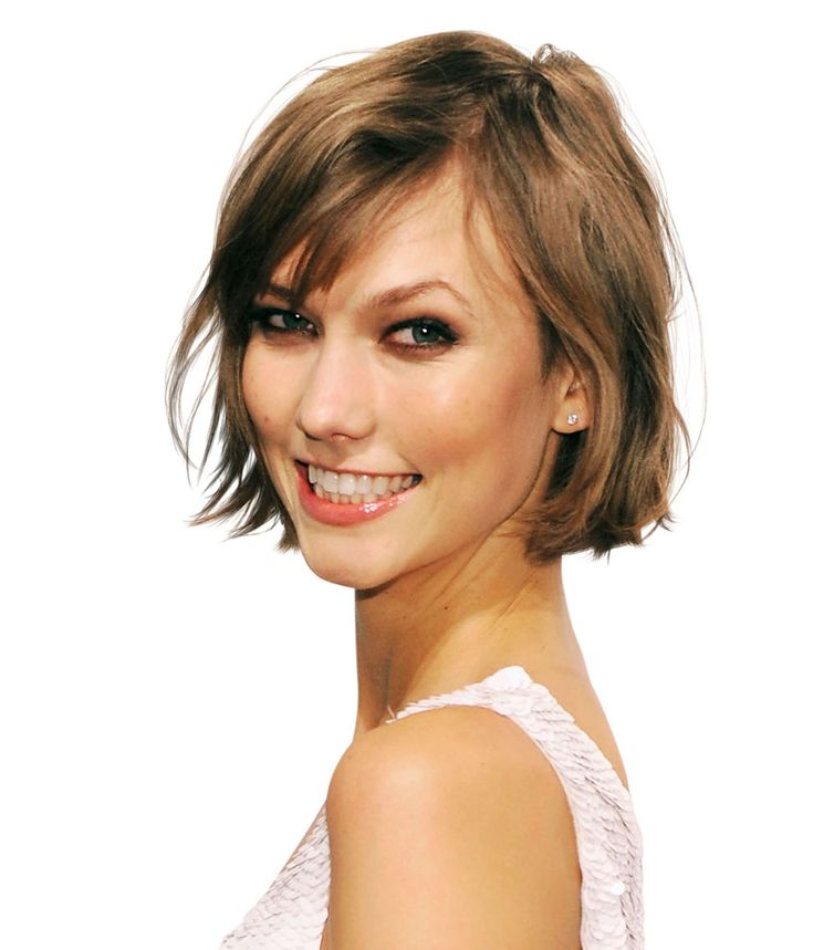 Karlie Kloss Breathe new life into fine hair with a chin-length bob and short, swept-aside bangs.