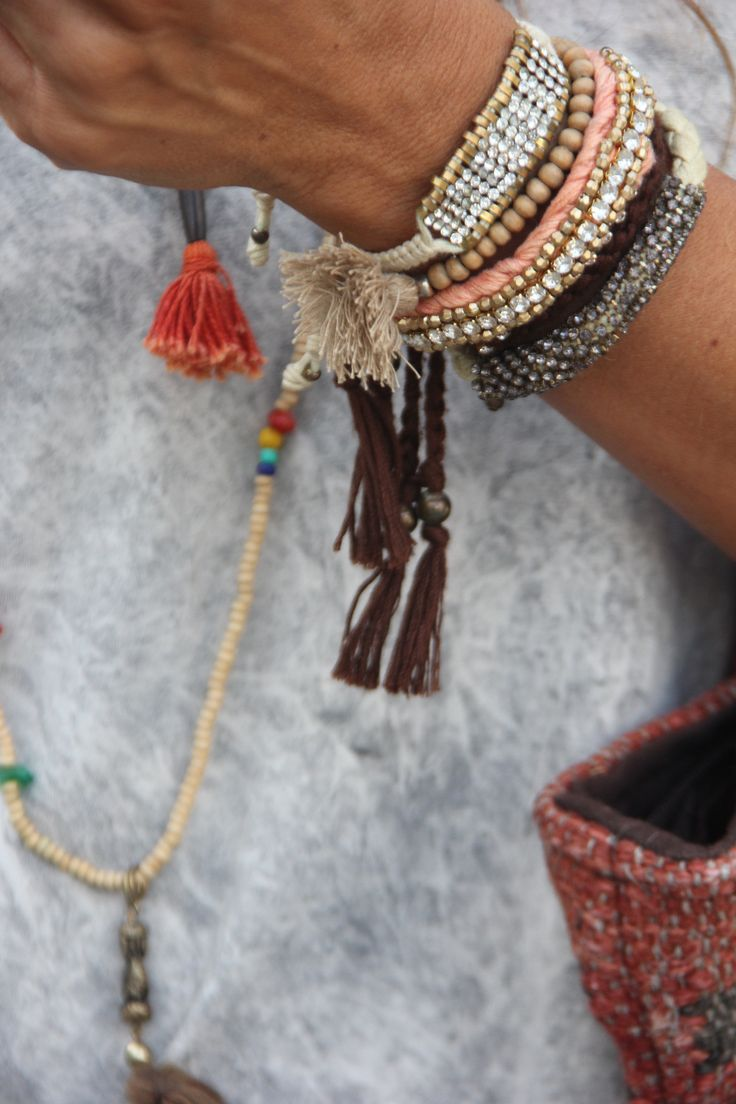 Gypsy jewelry, modern hippie stacking bracelets with tassels. For MORE Bohemian fashion trends FOLLOW http://www.pinterest.com/happygolicky/the-best-boho-chic-fashion-bohemian-jewelry-gypsy-/