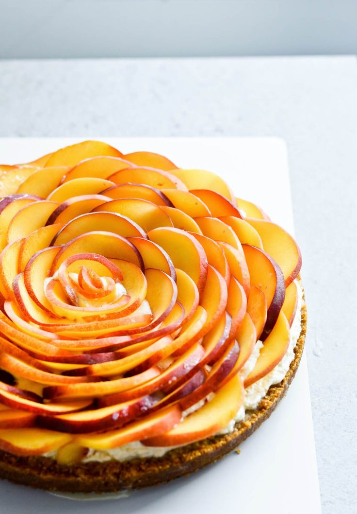 Whipped mascarpone peach tart - crumbly cookie crust filled with vanilla whipped…