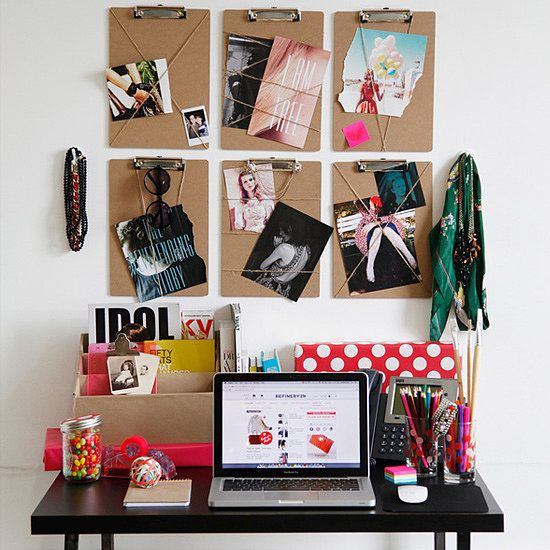 clip boards on he wall with bands on them is a cute idea for a bulletin board, you can get colored rubber bands or even thicker elastic