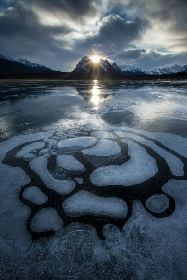 Bubbles begin to form on Abraham Lake (Alberta) by Paul Zizka / 500px