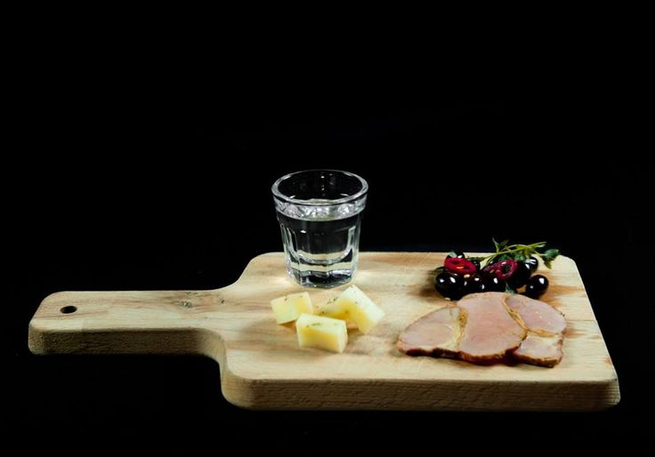 Creatan aged gruyere with thyme, smoked pork apaki, olives & raki. NU MODERN GREEK CUISINE CRETE PAPAROUNA WINE RESTAURANT & COCKTAIL BAR