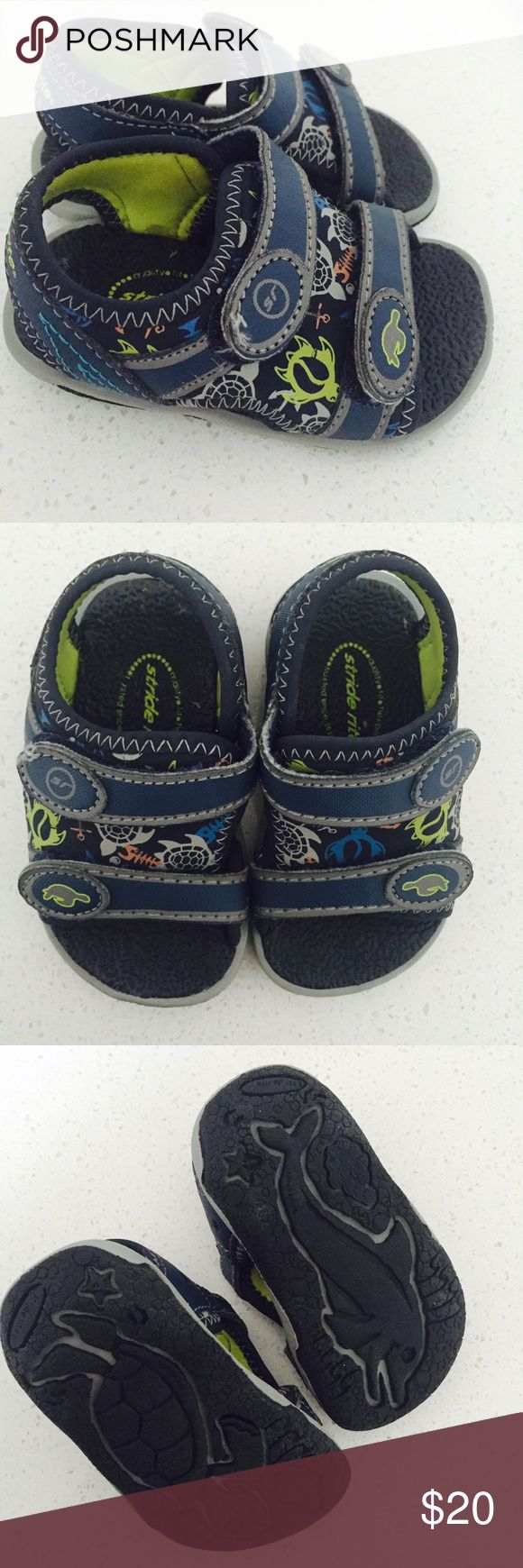 Stride Rite Everett Baby Sandals Like new, worn maybe twice, excellent condition. Purchased at Nordstrom. Navy blue with gray stitching. The shoes feature two Velcro straps and can be worn in the water as well, they have a turtle, fish and sea anchor design. So versatile and perfect for those early walkers.  Features: Synthetic and neoprene Rubber sole Water friendly Sleek, flexible, lightweight outsole Product Information Product Dimensions7.1 x 5.5 x 3.1 inches Item Weight10.4 ounces…