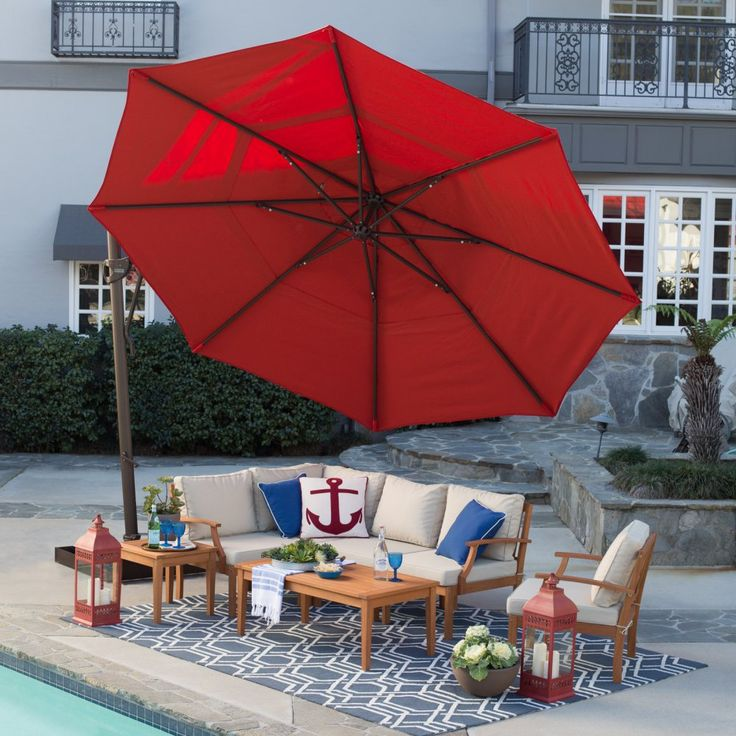 Buy Belham Living Sunbrella 13-ft. Rotating Offset Umbrella with Tilt and Base: Additional limited-time savings reflected in current price, Talk to our product specialists! View ratings, reviews or browse similar Patio Umbrellas at Hayneedle.