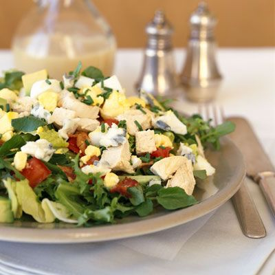 Skinny Chicken Cobb Salad:  Toss 2 cups salad greens, 1/2 cup shredded carrots, 1/4 chopped peeled avocado, 1 sliced hard-cooked egg, 2 ounces baked or skinless rotisserie chicken, and 2 tablespoons balsamic vinaigrette. | health.com
