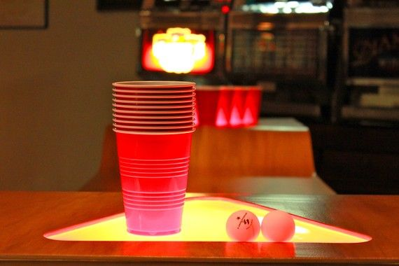 Custom designed Beer Pong Table with poplar wood, cast iron, and LED lights. Awesome.