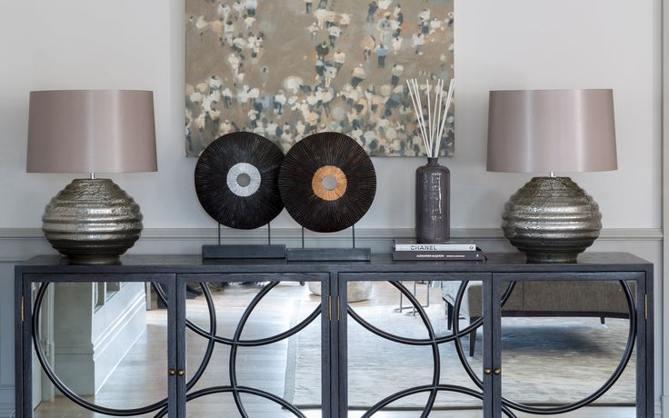 No living room is complete without a console table. A focal point in the design, this magnificent console by Julian Chicester is dressed with accessories befitting its beauty. #interiordesign #luxurylife #luxury #london #luxuryproperty #luxuryhomes #londonproperty #luxuryinteriors