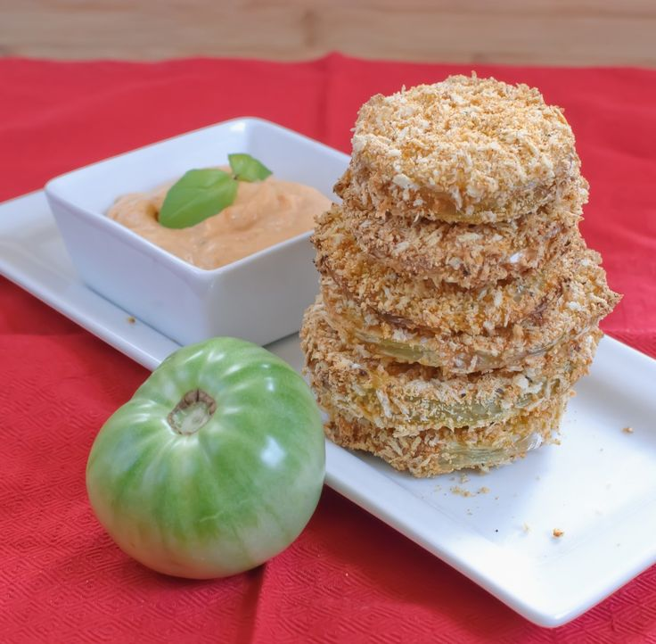 Oven baked fried green tomatoes. I used an egg replacer and sauce with vegan mayo and lemon, dill and some spice and relish. Delicious.