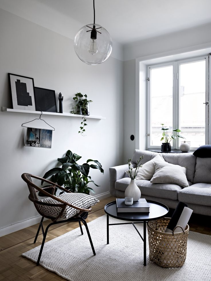 Scandinavian Inspired White Living Room With A Round Pendant Light Grey Couch