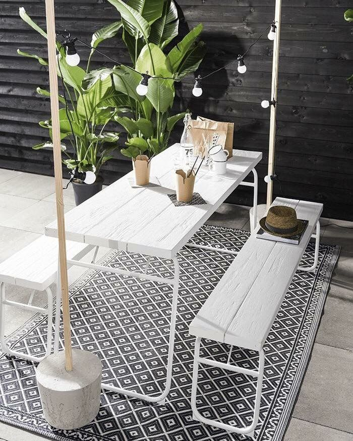 Patio | outdoor furniture and small living space decor! Monochrome + hanging light posts with simple picnic table are simple - statement pieces!