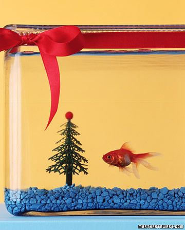 """Fish Tank Christmas Tree:  """"Bring joy to your pet's tank with a plastic Christmas tree. Attach a plastic bead to the top with silicone aquarium sealant (ask a grown-up to help).Wrap lead plant weights around the trunk or set it in a suction cup (for filtration tubes) stuck to the tank's floor."""""""