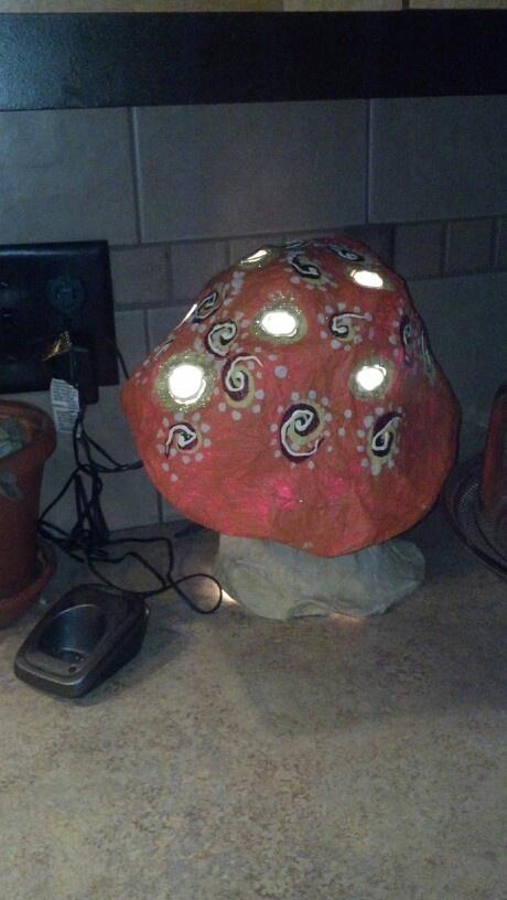 Paper mache mushroom light for '60s wedding.