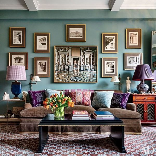 In the family room of Alexa Hampton's New York City apartment, a wall painted a Farrow & Ball blue displays images of architectural elements | archdigest.com