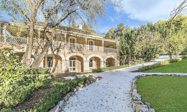 1857 sandstone manor. Provincial-style kitchen. A detached cottage. A solar heated swimming pool. Burnside. Luxury. Living. Lifestyle. Adelaide. South Australia.