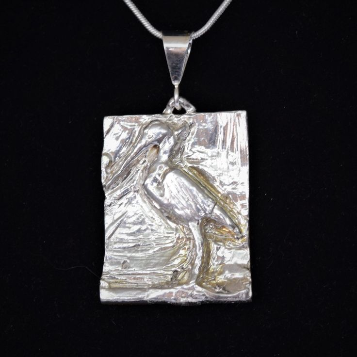 Hand Carved Sterling Silver Blue Heron Pendant  $65.00 Product Description  Sterling Silver hand carved blue heron pendant 1.5 inches in length