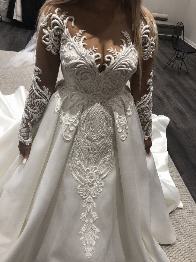 You can have this plus size long sheer sleeve wedding dress with ball gown over skirt made in any measurements.  We are US dress makers who specialize in custom #weddingdresses for fuller figured brides.  We can also make a #replica of any couture dress you love that will look like the original but cost way less.  Email us for pricing on custom plus size wedding dresses and inspired designs.