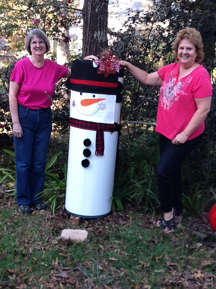 Busted water heater turned into frosty the snowman yard art sisters