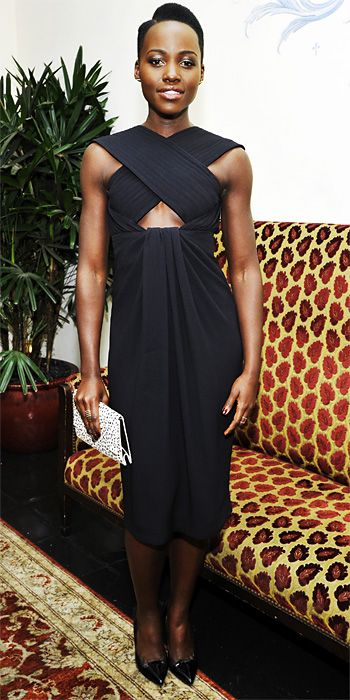 Lupita Nyong'o   Lupita Nyong'o was decked head to toe in Proenza Schouler, wearing a criss-cross cut-out LBD with a Dalmatian-print clutch and black pumps