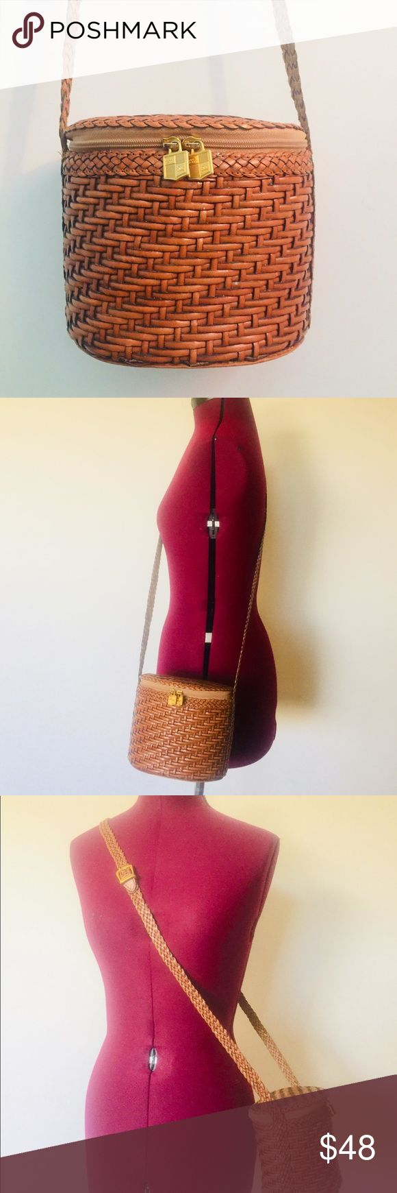 """Vintage Weaved Leather Cross Body Hand Bag Purse cognac weaved leather crossbody bag made in Brazil by Lisa Lauren.  The top of the bag is a pouch style with a zip around opening, the interior is lined in soft canvas fabric, it's one  open compartment and has one zippered pocket.  It has a long shoulder strap in braided leather and can be worn as a shoulder or cross body  Across: 9"""" Height: 6"""" Depth: 4.5"""" taken at bottom Strap Drop: 23"""" from the center of the strap to the top of the bag at…"""