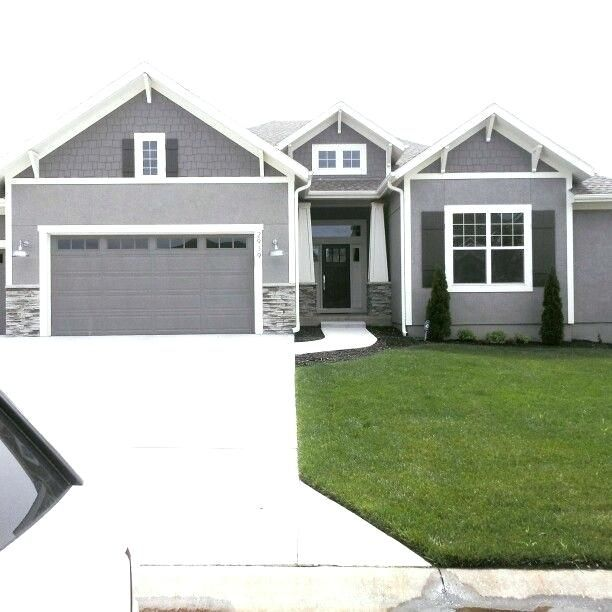 Stock Photos Grey Stucco House With Dormers Photo Modern Exterior Paint Colors Grey Exterior House Colors House Paint Exterior Exterior Paint Colors For House