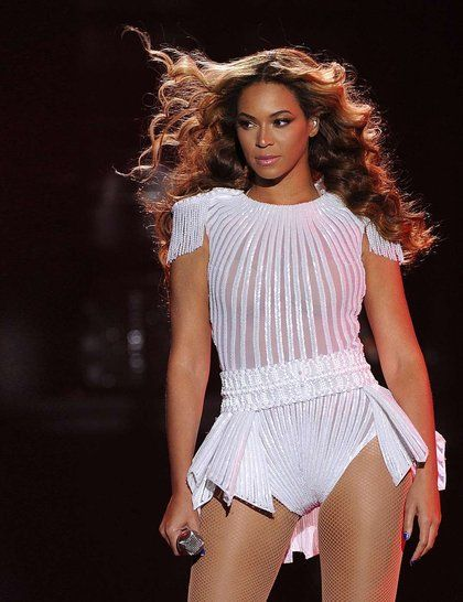 Beyoncé's The Mrs Carter Show World Tour Outfit - A ribbed white body a peplum waist and tasselled epaulettes marks a change of tempo.        #beyonce