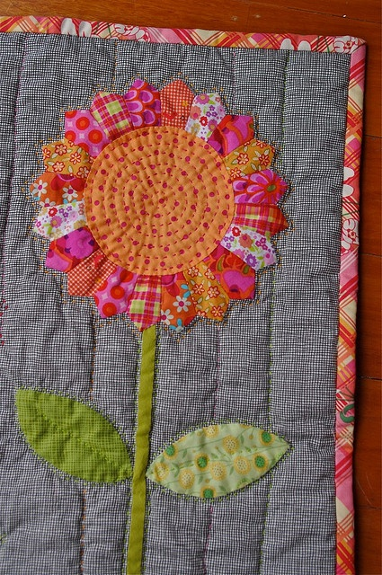 Flower quilt---how fresh are the colors of the flower on a gray background