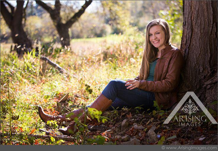 Natural senior pictures against a tree. Love the lighting! #arisingimages #michigan #girl #senior #pictures #rural #natural