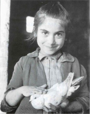 Cretan girl clutches a dove of peace, 1943.