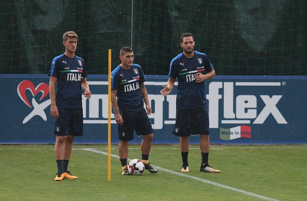 (L-R) Daniele Rugani, Marco Verratti and Danilo D'Ambrosio of Italy look on during the traning session at Coverciano on August 28, 2017 in Florence, Italy.