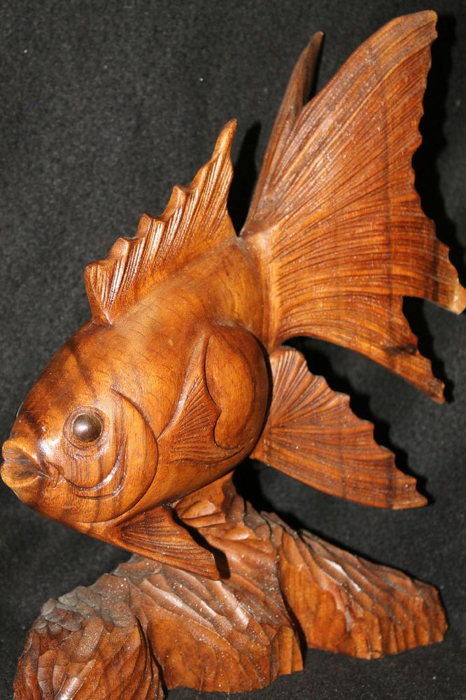 37 best hand carved fish images on pinterest hand carved for Koi fish statue