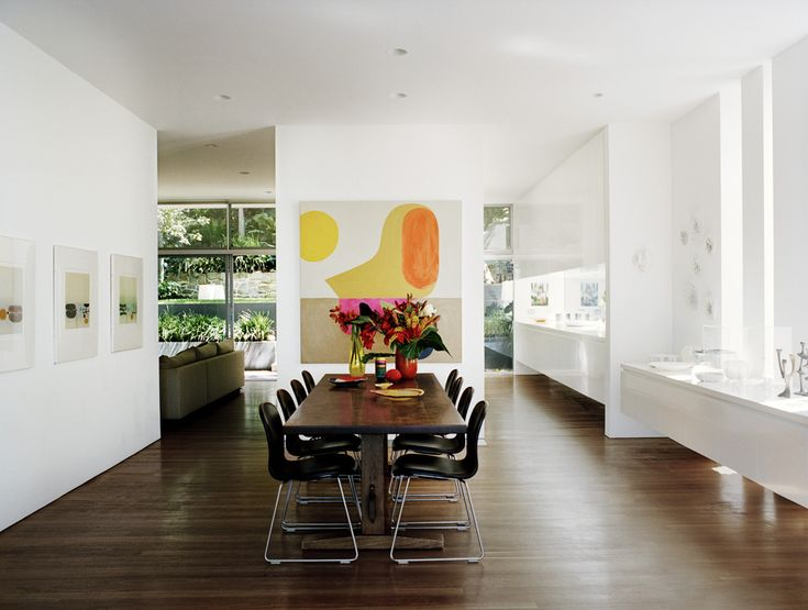 Large Dining Space With Modern Art And Bright White Walls