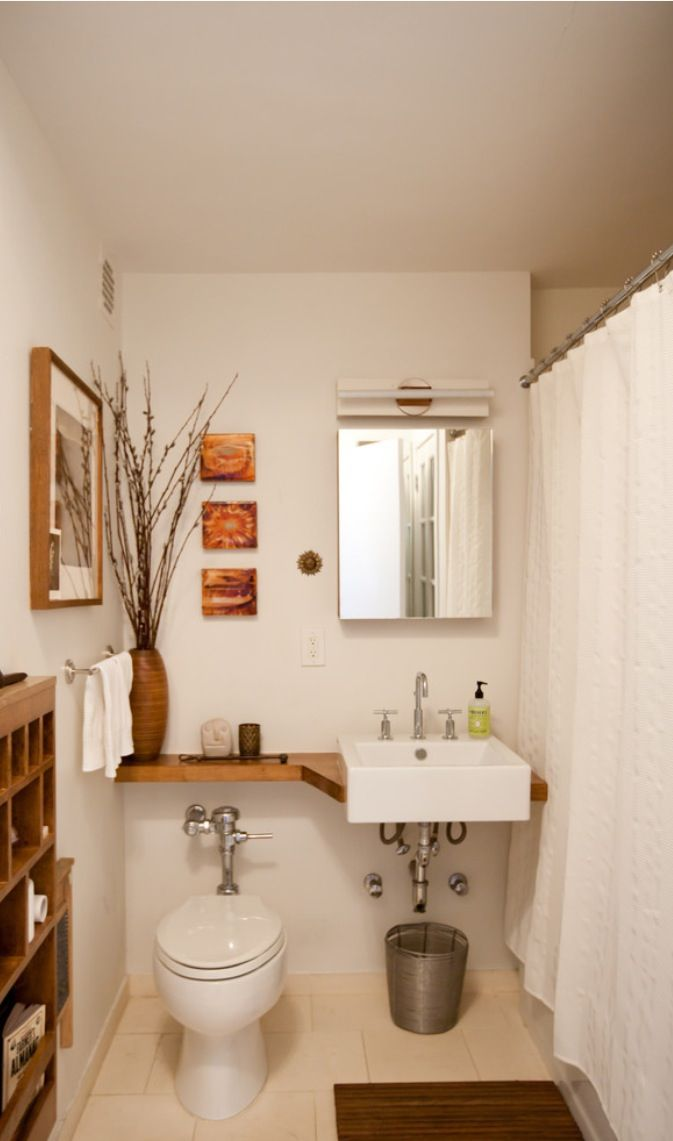 small bathroom.                                              {{ sink in corner with extending shallow shelf along wall }}