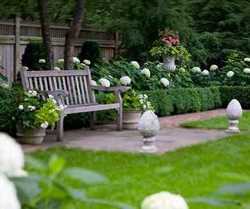 I love the bench with boxwood, hydrangeas, and the addition of the planters.