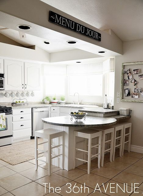 Love the white kitchen and the gray countertops. I also really like the layout of this little kitchen and think it may work for us with modifications.