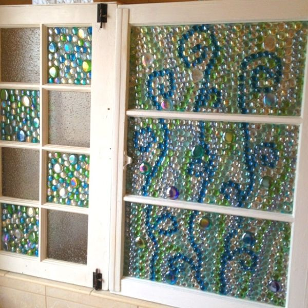 Old windows with glass beads glued on with glass glue. by maribel