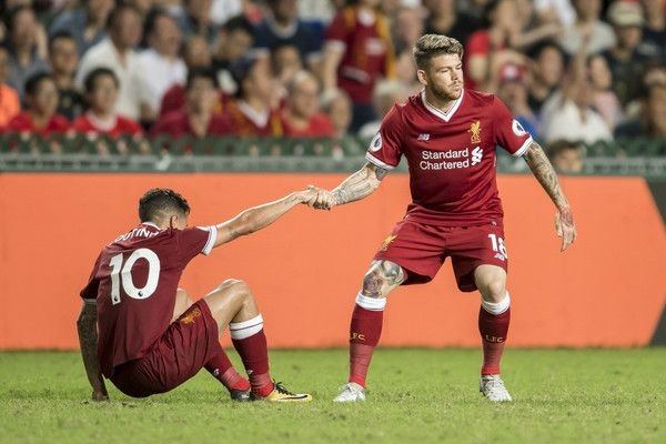 Liverpool FC midfielder Philippe Coutinho (L) is helped up by teammate Alberto Moreno during the Premier League Asia Trophy match between Liverpool FC and Leicester City FC at Hong Kong Stadium on July 22, 2017 in Hong Kong, Hong Kong.