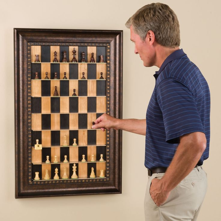 The Vertical Chess Set - Hammacher Schlemmer.  This would be really neat gift to make for a mens gift.  Old frame, some painted wood, and old chess set:)
